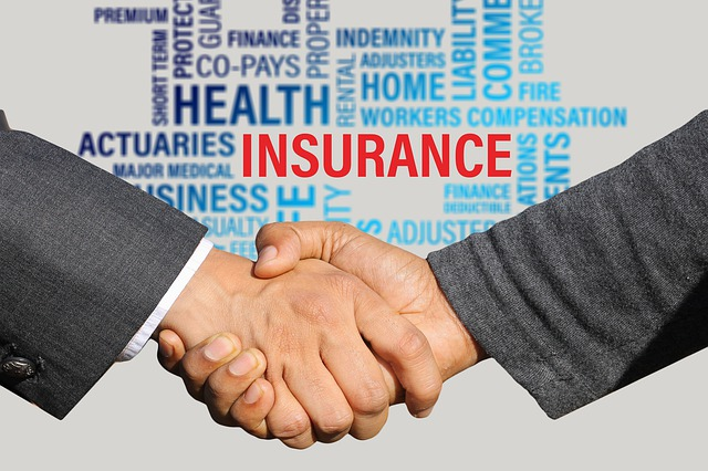 agents shaking hands in front of an insurance word cluster
